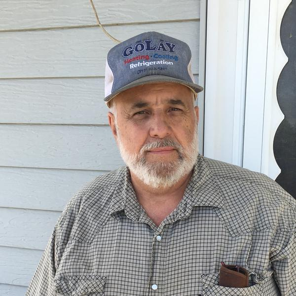 Owen Golay, 60, runs a heating and cooling business in Pleasantville, Iowa. Although he's a native Iowan, he says he's drawn to the Confederate flag and what he describes as Southern history and heritage.