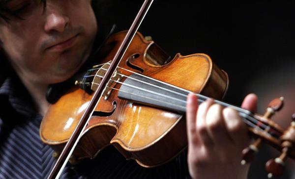 "Violinist Adrian Pintea, from The Julliard School, plays a 1729 Stradivari known as the ""Solomon, Ex-Lambert"" in 2007 at Christie's in New York."