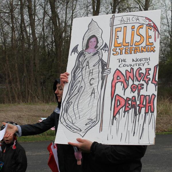 Protesters outside a town hall meeting held by Rep. Elise Stefanik, R-N.Y., in Plattsburgh.