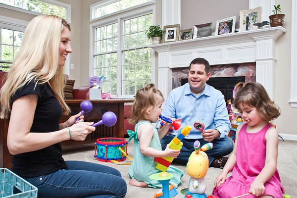 Larry and Carolyn Bloomstein play with their daughters Aria, 2, (left) and Hailey, 5, at home in New Jersey.
