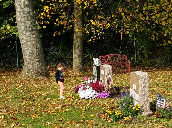Hailey, now 5, at her mother's grave.