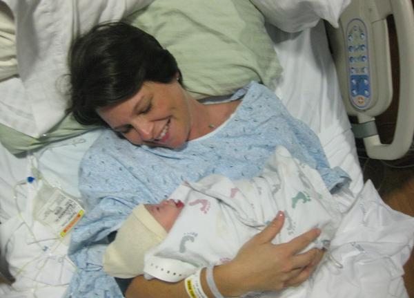 Lauren Bloomstein holds her newborn daughter.