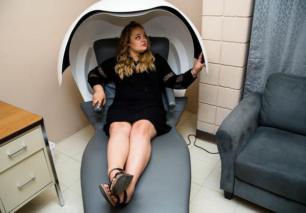 Hannah Vanderkooy demonstrates the napping pod she uses at Las Cruces High School in Las Cruces, N.M.