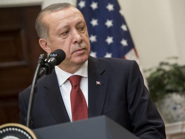 Turkish President Recep Tayyip Erdogan speaks to the media Tuesday following meetings with President Trump at the White House. Hours later, a protest at the Turkish ambassador's residence in Washington, D.C., turned violent.