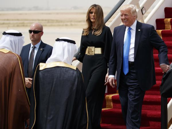 President Trump, accompanied by first lady Melania Trump, smiles at Saudi King Salman (left) upon his arrival in Riyadh, Saudi Arabia.