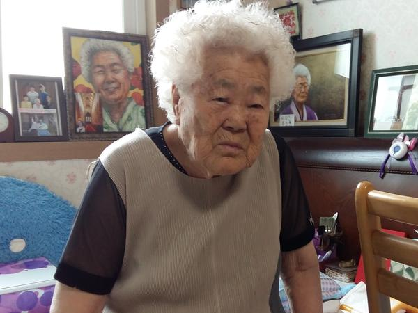 Lee Ok-seon, 90, is one of the last surviving Korean comfort women, who were forced into prostitution by Japanese occupying forces in WWII. Lee was kidnapped from her parents at age 15, and brought to work in a brothel in a Japanese-occupied region of China. Here she is pictured in her nursing home, east of Seoul.