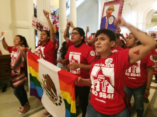 Demonstrators march in the Texas Capitol in Austin on Monday, protesting the state's newly passed anti-sanctuary cities bill, which empowers police to inquire about people's immigration status during routine interactions such as traffic stops.