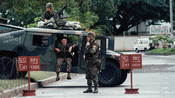 U.S. troops man a roadblock on Dec. 26, 1989, in Panama City, preventing access to the Vatican Embassy where Panamanian leader Manuel Noriega was holed up. The U.S. forces played loud rock music in an attempt to bring Noriega out. He surrendered on Jan. 3, 1990.