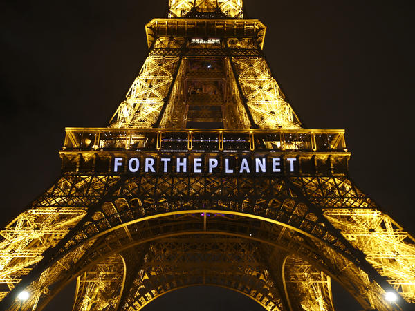 "The slogan ""For The Planet"" is projected on the Eiffel Tower as part of the United Nations Climate Change Conference in Paris in December 2015."