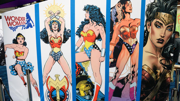 A Wonder Woman display at Comic-Con International 2016 shows the evolution of her incredible shrinking costume.