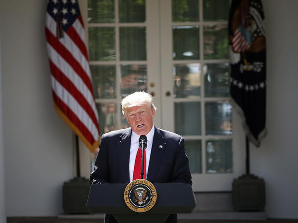 President Trump announces his decision for the United States to pull out of the Paris climate agreement in the Rose Garden at the White House on Thursday.