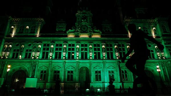 The City Hall of Paris is illuminated in green on Thursday, after the announcement by President Trump that the United States will withdraw from the 2015 Paris accord and try to negotiate a new global deal on climate change