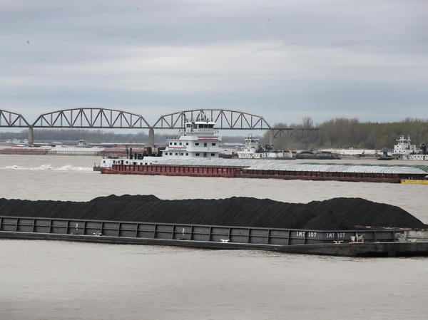 A barge loaded with Illinois Basin coal sits in the Ohio River in Cairo, Ill.