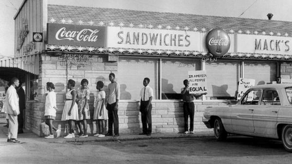 Cairo was a site of racial tension in the 1960s. Here, protesters are seen in 1962 outside Mack's Barbecue.