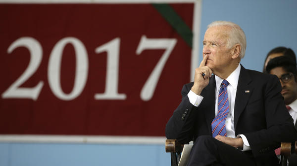 Former Vice President Joe Biden listens while seated on the stage during 2017 Harvard College Class Day exercises last week.