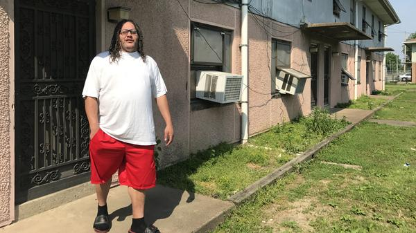 """Melvin Duncan, 38, works for the Cairo School District and says he'll wait until the bitter end to leave the McBride Housing Projects. """"They're literally going to have to put me out,"""" he says."""