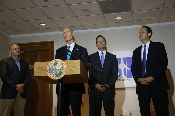 Gov. Rick Scott announces that he will sign the state budget, and call a special session to add hundreds of millions more for schools, jobs and tourism marketing.