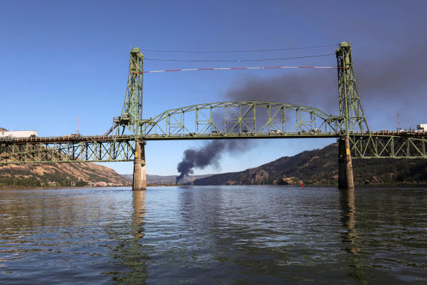 <p>Smoke from an oil train fire is seen beyond the Hood River Bridge in the Columbia River Gorge on Friday, June 3, 2016.</p>