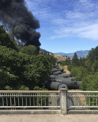 <p>In this photo provided by Silas Bleakley, tank cars, carrying oil, are derailed Friday, June 3, 2016, near Mosier, Ore. The accident happened just after noon about 70 miles east of Portland. It involved numerous cars filled with oil, and one was burning. Highway 84 was closed for a 23-mile stretch between The Dalles and Mosier and the radius for evacuations was a half-mile. </p>