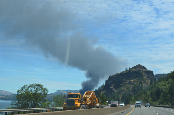 <p>Smoke rises from an oil train that derailed near Hood River Friday.</p>