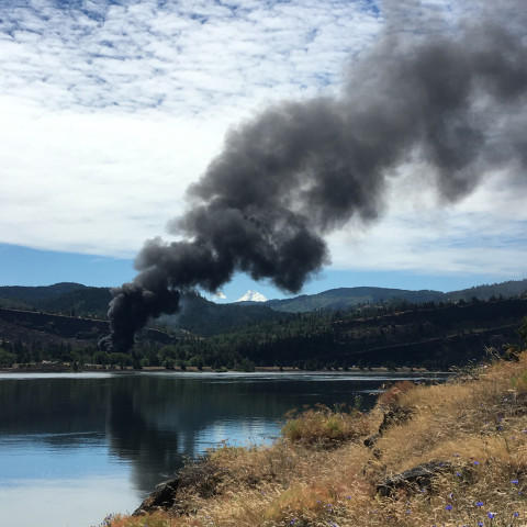<p>Smoke rises from an oil train that derailed in Mosier, near Hood River, Friday.</p>