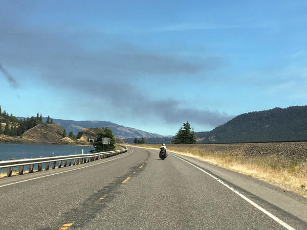 <p>Smoke from a trail derailment fire as seen from Washington state Route 14.</p>