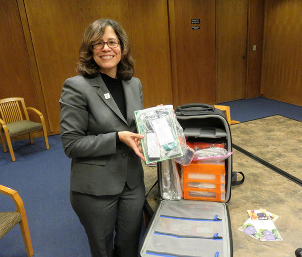 Bloodworks Northwest COO Linda Barnes poses with the prototype BloodPak