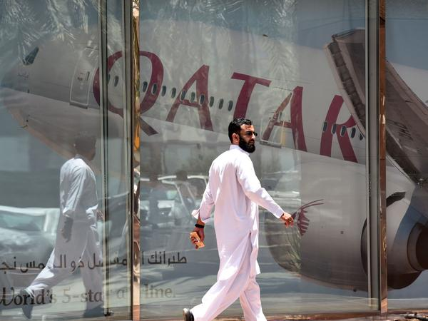 A man walks past the Qatar Airways branch in the Saudi capital, Riyadh, on Monday. Saudi Arabia and other Gulf states severed relations with Qatar and restricted Qatari planes' use of their airspace.