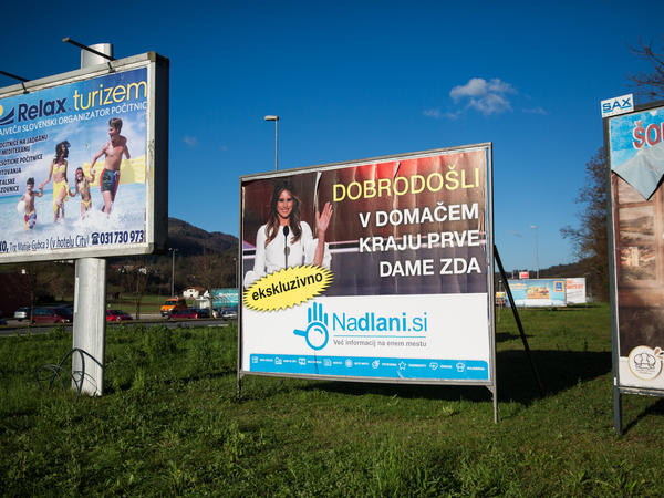 """A sign reading """"Welcome to the Hometown of the First Lady"""" in Slovenian is pictured among other billboards in November 2016 in Sevnica, Slovenia, where Melania Trump was raised."""
