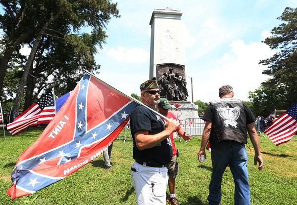 Supporter Steve Stepanek of St. Louis waves his Confederate flag at the Confederate Statue in Forest Park on Saturday in St. Louis.