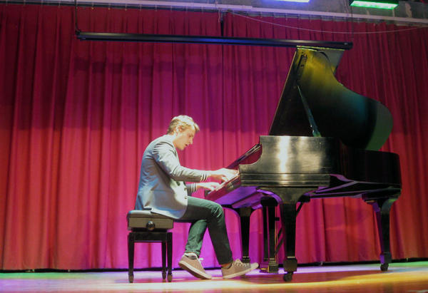 Russian native Sergey Belyavskiy on the auditorium stage of Fort Worth's Westcliff Elementary. The school adopted him as part of the Clilburn arts in education program during the international piano competition.