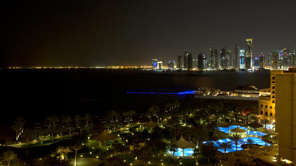 The skyline of Doha, Qatar, is seen at night in 2013. Saudi Arabia and three other countries severed ties to Qatar on Monday and moved to cut off land, sea and air routes to the energy-rich nation, accusing it of supporting regional terror groups.