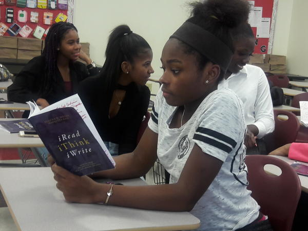 "A student in the Freshman Experience class at Miami Norland reads from the book the class published called, ""iRead iThink iWrite."""