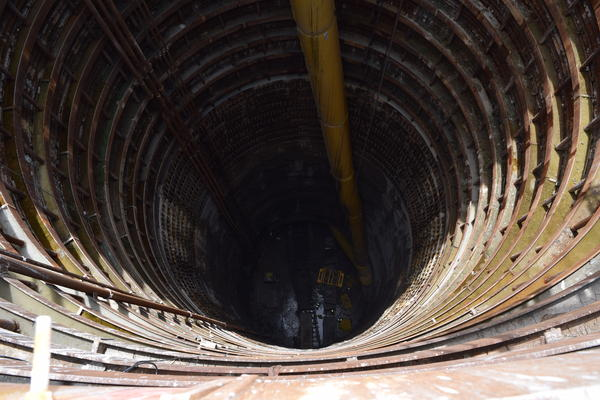 Carrying pieces of the tunnel, a crane will travel down this shaft