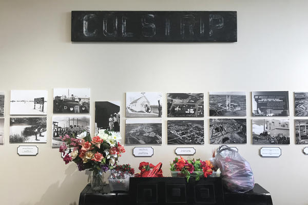 "Colstrip's history is laid out in old photos that line the walls of the town's historical center. ""That's who we are,"" says Lu Shomate, the center's director. ""If it wasn't for the coal and then the generation [of electricity], of course, none of this would be here."""