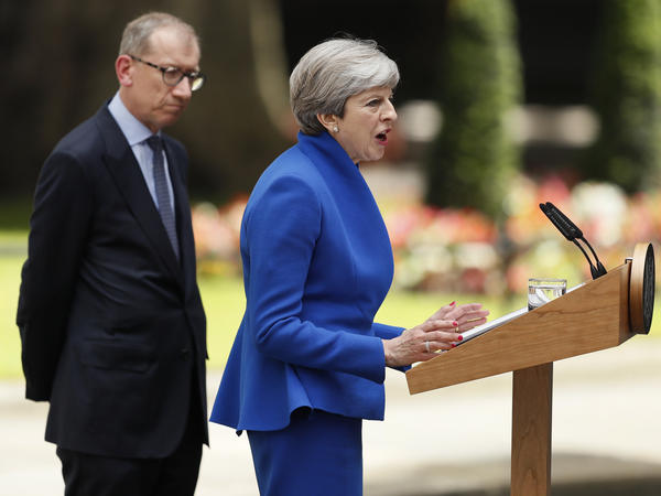 British Prime Minister Theresa May speaks next to her husband Philip in London Friday. May's gamble in calling an early election backfired, as her Conservative Party lost its majority in Parliament.