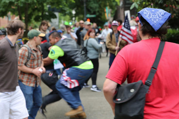 "<p>Tusitala ""Tiny"" Toese, center, a known member of the militia style group, the Oath Keepers, was photographed tackling an antifa protester before federal law enforcement officers detained the protester and arrested him. </p>"