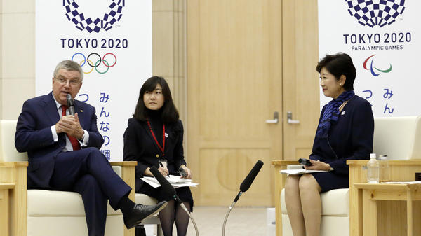 International Olympic Committee President Thomas Bach says new changes will boost female participation in the Olympics and attract young, urban viewers. He is seen here last fall, with Tokyo Gov. Yuriko Koike (right) and an interpreter.