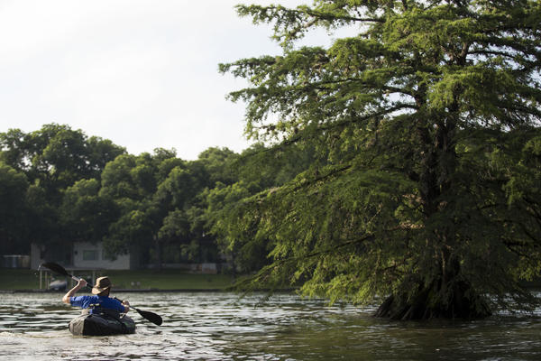 Jason Dzubinski takes a 10-minute trip across Lake Austin two days a week for work. After that, he hikes through West Lake to his office.