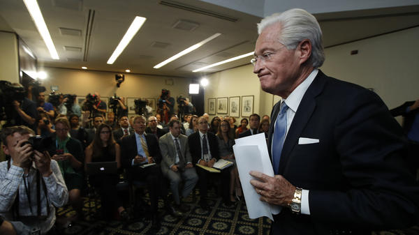 Marc Kasowitz, Trump's personal attorney, leaves a packed room at the National Press Club in Washington on Thursday, after disputing the testimony of Comey earlier that day.