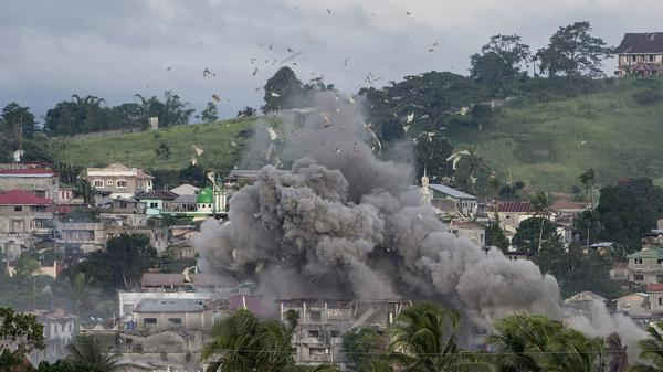 "An airstrike rips through a suspected militant hideout in Marawi on Friday. The U.S. is now providing ""technical assistance"" in the fight to retake the city, according to a Philippine military spokesman."