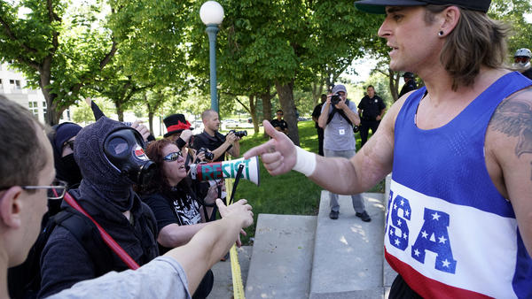 "A participant (who refused to give his name) in the ""Denver March Against Sharia"" speaks to counter-demonstrators on Saturday in Denver."