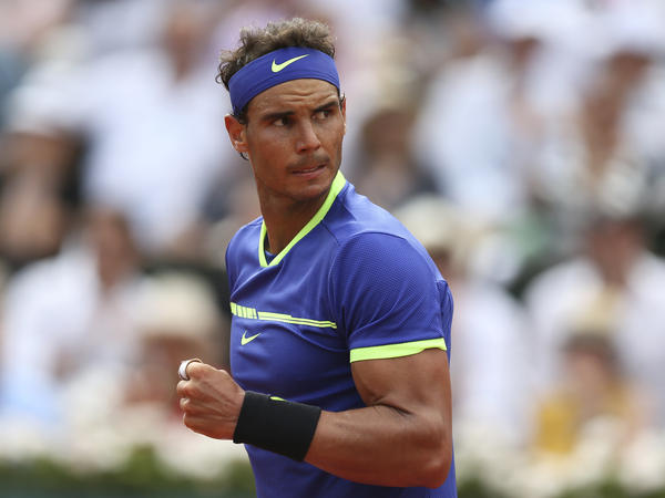 Rafael Nadal celebrates a point against Stan Wawrinka during the final of the French Open. Nadal, who has dominated on clay in his career, did not leave the outcome in doubt for long. The Spaniard claimed his record 10th French Open title on Sunday.