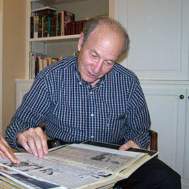 Bernard Cohen in 2007, looking at newspaper clippings about the case.
