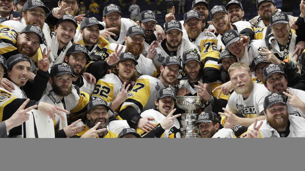 Pittsburgh Penguins players celebrate Sunday after defeating the Nashville Predators 2-0 in Game 6 of the NHL Stanley Cup Final in Nashville, Tenn.