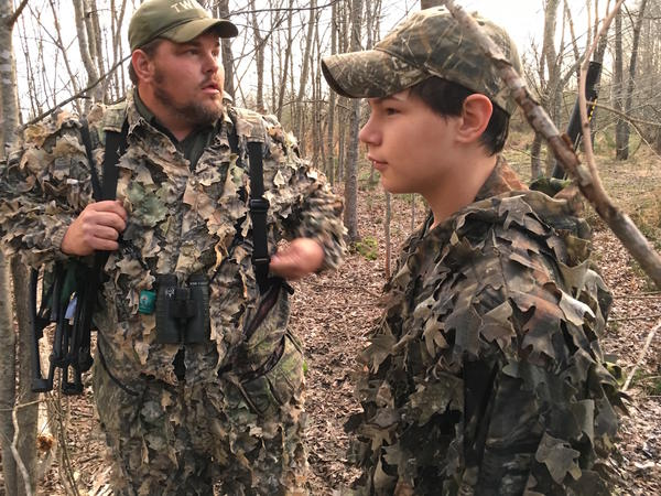 Leith Konyndyk and his son Lake survey the woods in Lincoln County as they look and listen for signs of turkeys.