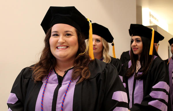 Kristen Alexander lines up with her classmates at Missouri School of Dentistry to receive her degree Saturday. The Poplar Bluff native has accepted a job at a community health center in her hometown.