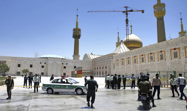 Iranian police officers secure the area around the mausoleum of Ayatollah Ruhollah Khomeini following an assault there and on the country's parliament building that left at least 17 people dead last week.