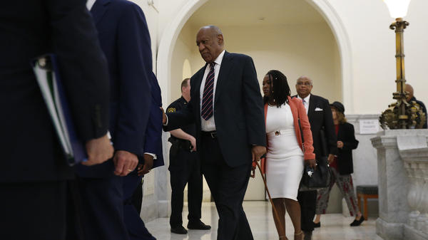 Bill Cosby returns to the courtroom following a break in his trial Monday in Norristown, Pa. A former Temple University employee alleges that Cosby drugged and molested her in 2004 at his home in suburban Philadelphia. The defense team rested after just six minutes.