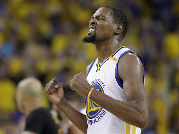 Golden State Warriors forward Kevin Durant reacts after scoring against the Cleveland Cavaliers on the way to the Warriors' second NBA title in three years.